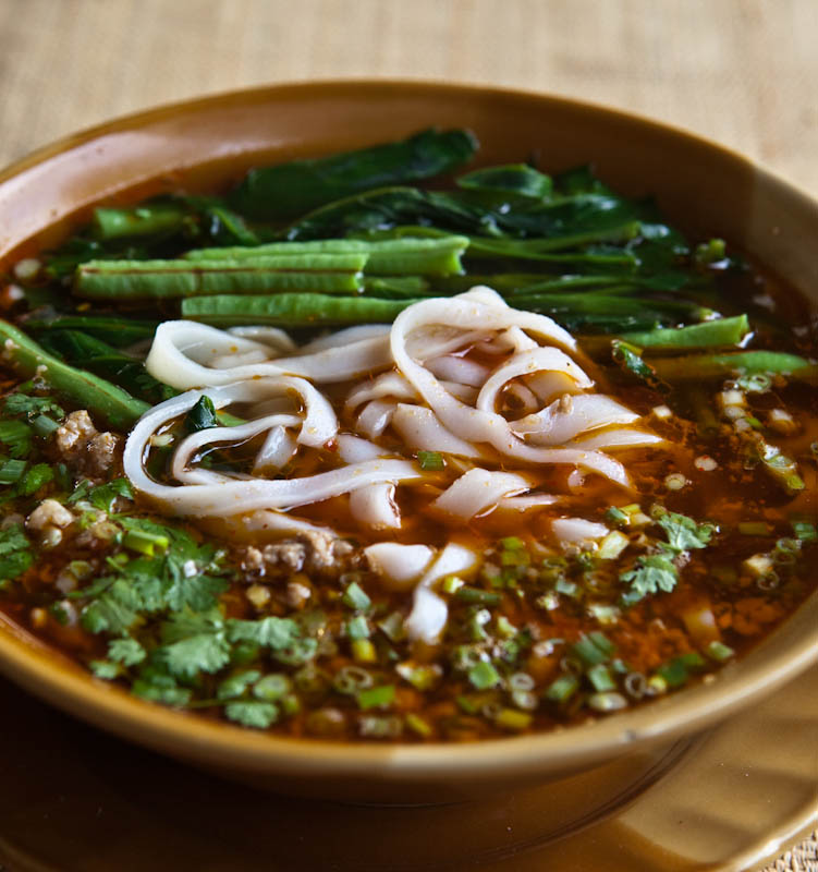 Kao soi with parboiled vegetables ເຂົ້າຊອຍ ກັບ ຜັກລວກ kao soi gap pak luak, which contain a generous dose of pork sauce made with fermented soy bean paste