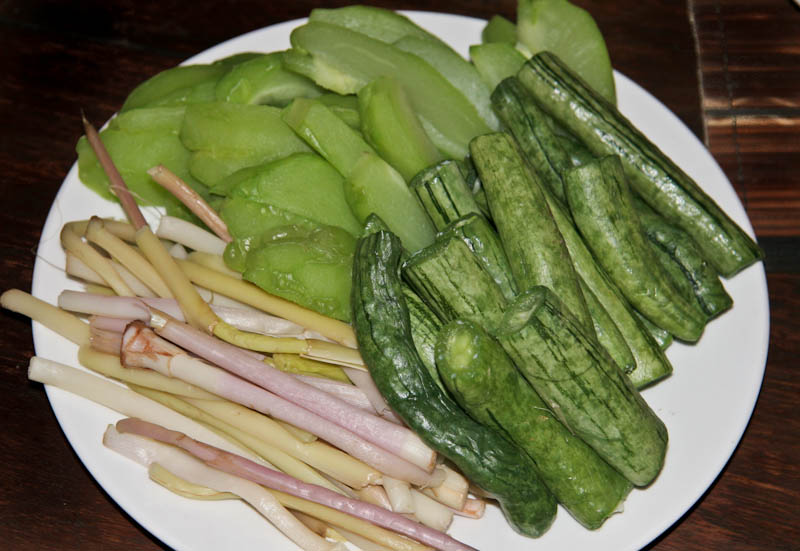 Steamed choko, snake gourd and galangal shoots to be eaten with either a jeow or poon pa