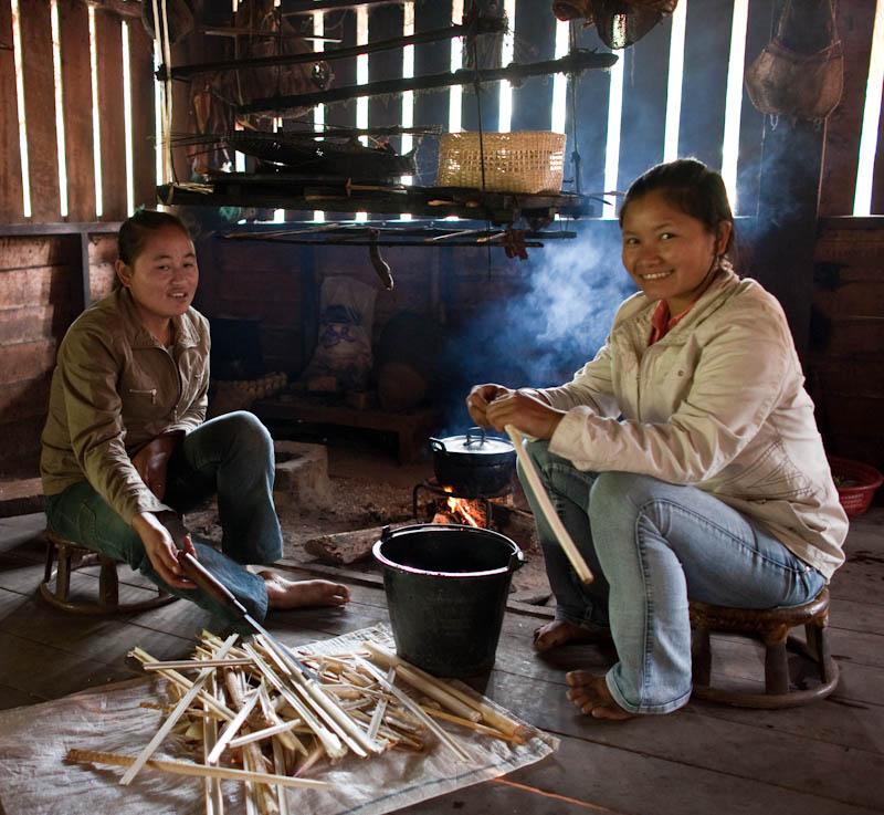 Young Khmu women stripping rattan in Ban Chalensouk