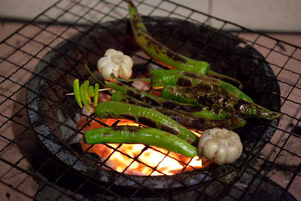 Grilling chillies and garlic