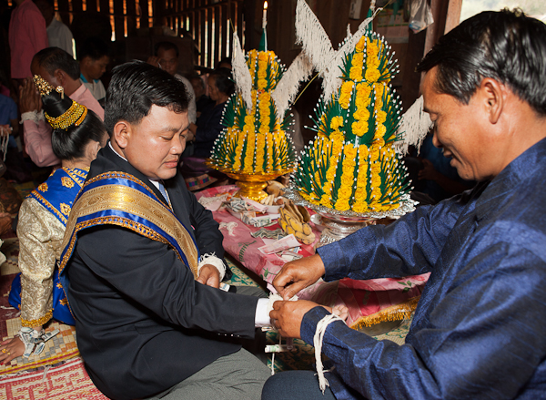 Tying strings on the Groom