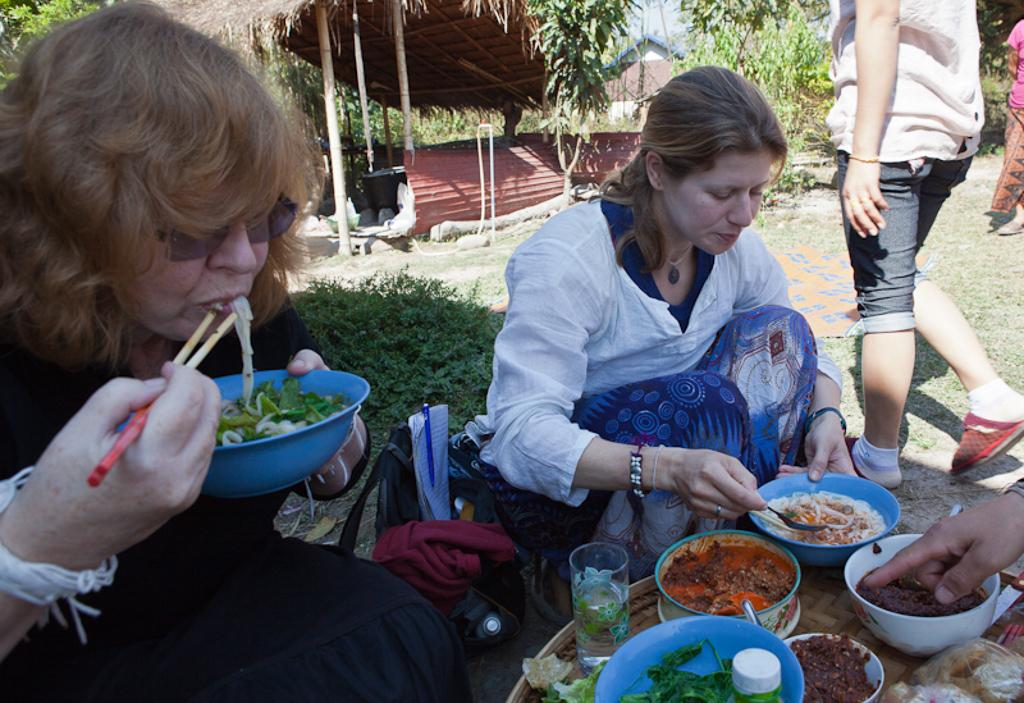 slurping khao soi noodles